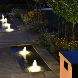 Schaumsprudler Fountain with Underwater Lighting at Night