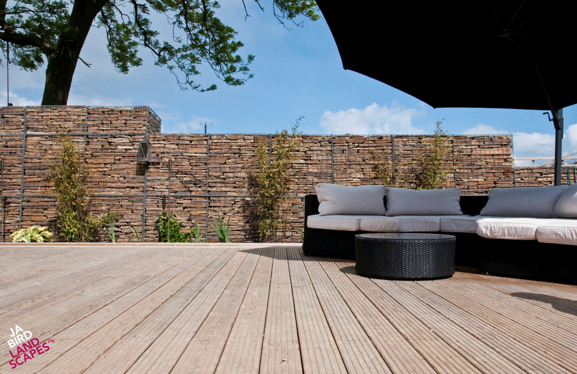 Softwood decking with and gabions – metal baskets filled with stone