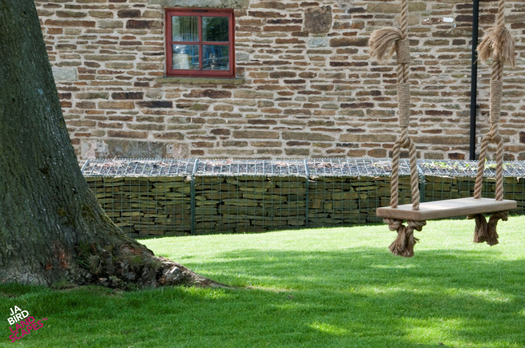 Natural stone blends well with the farmhouse stonework of the house