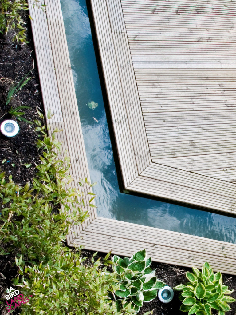 An innovative water feature runs along two sides of the decking